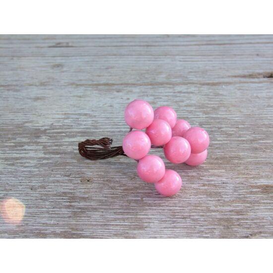 Rózsaszín betűző bogyók